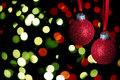 Red christmas balls with glitter on abstract lights background Royalty Free Stock Photography