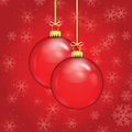 Red christmas balls on a gold ribbon background of falling snowflakes Royalty Free Stock Photography