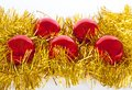 Red christmas balls on gold tinsel Royalty Free Stock Photos