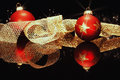 Red christmas balls with golden metal ribbon Royalty Free Stock Photo