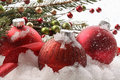 Red christmas balls in the snow Royalty Free Stock Image