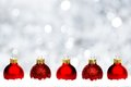 Red Christmas baubles in snow with silver background Royalty Free Stock Photo