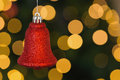 Red christmas bell decoration hanging on blurred background Stock Photography