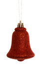 Red christmas bell decoration hanging on white background Stock Images
