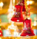 Red Christmas-bell hanging at tree Royalty Free Stock Photo