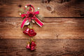 Red christmas bells on wood background. Xmas toy Royalty Free Stock Photo