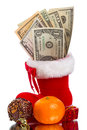 Red Christmas boot with dollars and gifts Royalty Free Stock Photo