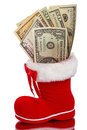 Red Christmas boot with dollars Royalty Free Stock Photo