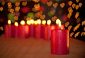 Red Christmas candle burning on a wooden table Royalty Free Stock Photos