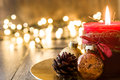 Red Christmas candle and Christmas ornaments Royalty Free Stock Photo