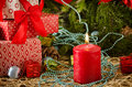 Red christmas candle gifts balls cones flame Royalty Free Stock Photo