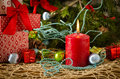 Red christmas candle gifts pine cones flame Royalty Free Stock Photo