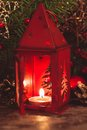 Red christmas candlestick over holiday decorations on the table Stock Images