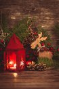 Red christmas candlestick over holiday decorations on the table Stock Photos