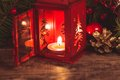 Red christmas candlestick over holiday decorations on the table Royalty Free Stock Photos