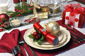 Red Christmas Day Table Setting With Present Stock Photos