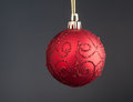 Red christmas decoration ball on grey background Royalty Free Stock Photo
