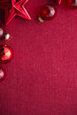 Red christmas decorations stars and balls on red canvas background. Merry christmas card. Royalty Free Stock Photo