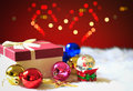 Red Christmas gift box and bokhe on background of defocused colo Royalty Free Stock Photo