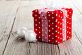 Red christmas gift box polka dots on wood background Royalty Free Stock Photo