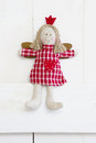 Red christmas or guardian angel in white checkered red country dress countrry style Stock Photos