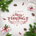 Red Christmas and New Year Typographical on white background with fir branches, gift boxes, pine cones, garland of stars Royalty Free Stock Photo