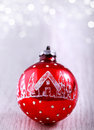 Red Christmas ornament on glitter silver background with space for text. Merry Christmas and New Year card