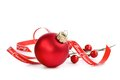 Red Christmas ornament with merry Christmas ribbon Royalty Free Stock Photo