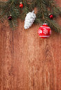 Red Christmas ornaments and fir tree branch on a rustic wooden background Royalty Free Stock Photo