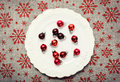 Red Christmas ornaments on white. Canvas background with red glitter snowflakes. Xmas card. Happy New Year. Space