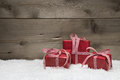 Red christmas presents with checkered bows on grey wooden backgr background Stock Photo