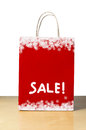 Red christmas sale bag a winter or shopping in with white snowflake borders at top and bottom and the word in the lower half Stock Photos