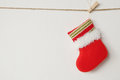 Red Christmas sock hanging on white wall background Royalty Free Stock Photo
