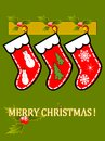 Red christmas socks three empty on green background merry message postcard Stock Photos