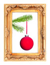 Red christmas tree ball at a fir branch in a picture frame isolated before white Stock Images