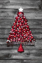 Red christmas tree with balls on old wooden shabby background. Royalty Free Stock Photo