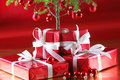 Red Christmas tree, red presents Royalty Free Stock Images