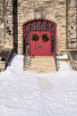 Red Church Doors with Wreaths Royalty Free Stock Photo