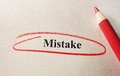 Red circle mistake and pencil on textured paper Stock Photos
