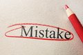 Red circle mistake and pencil on textured paper Stock Photography