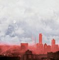 Red city skyline with cloudy sky and full moon. Concept of global warming. Royalty Free Stock Photo