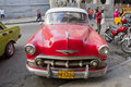 Red classic cuban car diagonal parking in street havana cuba Stock Photos