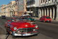 Red classic old american car on malecon havana cuba february in the streets of havana cars are still in use in cuba and timers Stock Photo