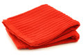 Red cleaning cloth on a white background Royalty Free Stock Images