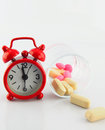 Red clock and tablet in glass on white backgroud Royalty Free Stock Image
