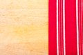 Red cloth with white lines on a chopping board Royalty Free Stock Photography