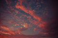Red cloud fire in the sky cloudscape background Stock Photos