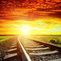 Red clouds and railroad to horizon sunset with Stock Photography