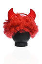 Red clown wig with devil horns Royalty Free Stock Photos