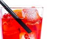 Red cocktail with ice cubes and straw on white background Royalty Free Stock Photo